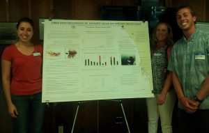 Niko Kaplanis at the poster show with his co-authors: Dr. Jennifer Smith and Jill Harris